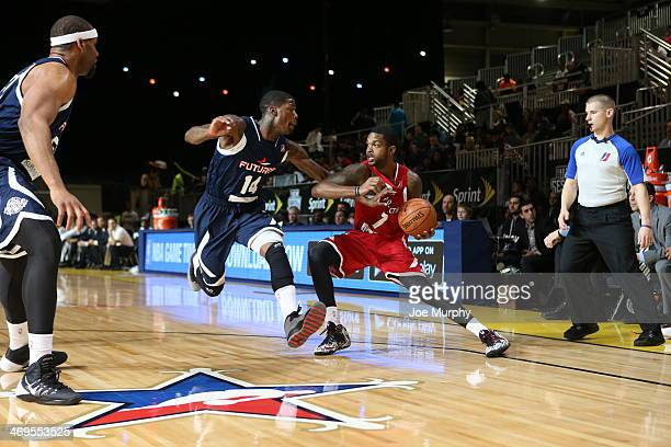 Troy Daniels of the Prospects drives against DeAndre Liggins of the Futures during the NBA DLeague AllStar Game at Sprint Arena as part of 2014 NBA...