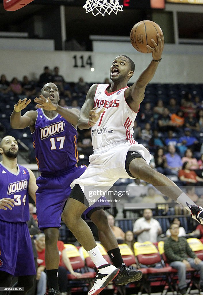 Troy Daniels #7 of the Rio Grande Valley Vipers takes the ball to the basket against Moses Ehambe #17 of the Iowa Energy on April 8, 2014 during game one first round of the 2014 NBA-Development League playoffs at the State Farm Arena in Hidalgo, Texas.