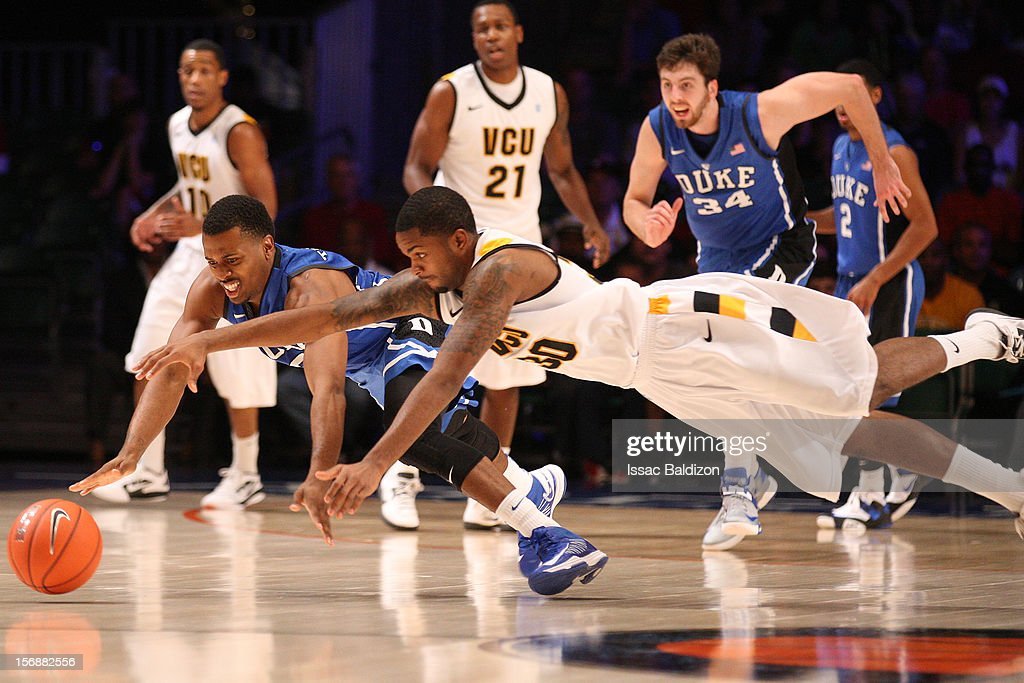Troy Daniels #30 of the VCU Rams and Tyler Thornton #3 of the Duke Blue Devils dive for a loose ball during the Battle 4 Atlantis tournament at Atlantis Resort November 23, 2012 in Nassau, Paradise Island, Bahamas.