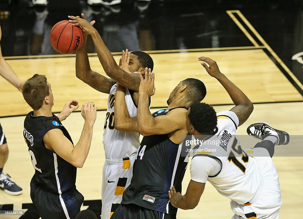 Troy Daniels #30 of the VCU Rams tries to rebound as he is hit by Zeke Marshall #44 of the Akron Zips as Brian Walsh #2 defends and Juvonte Reddic #15 battles during the second round of the 2013 NCAA Men's Basketball Tournament at The Palace of Auburn Hills on March 21, 2013 in Auburn Hills, Michigan. VCU defeated Akron 88-42.