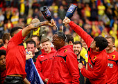 Troy Deeney and Fernando Forestieri pour chamagne on Lloyd Doyley as they celebrate promotion to the premier league during the Sky Bet Championship...