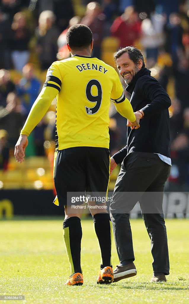 Troy Deeney (L) and Quique Flores (R) manager of Watford celebrate their 3-2 win in the Barclays Premier League match between Watford and Aston Villa at Vicarage Road on April 30, 2016 in Watford, England.