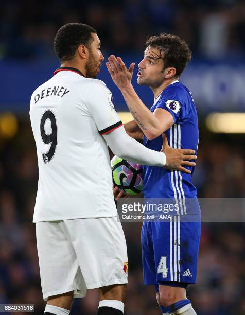 Troy Deeney of Watford and Cesc Fabregas of Chelsea have words during the Premier League match between Chelsea and Watford at Stamford Bridge on May...