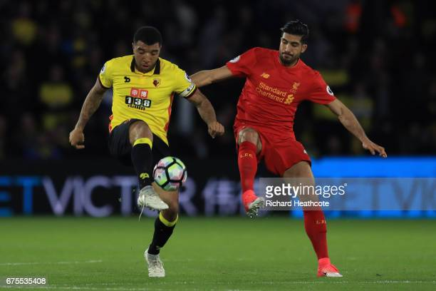 Troy Deeney of Watford and Emre Can of Liverpool compete for the ball during the Premier League match between Watford and Liverpool at Vicarage Road...