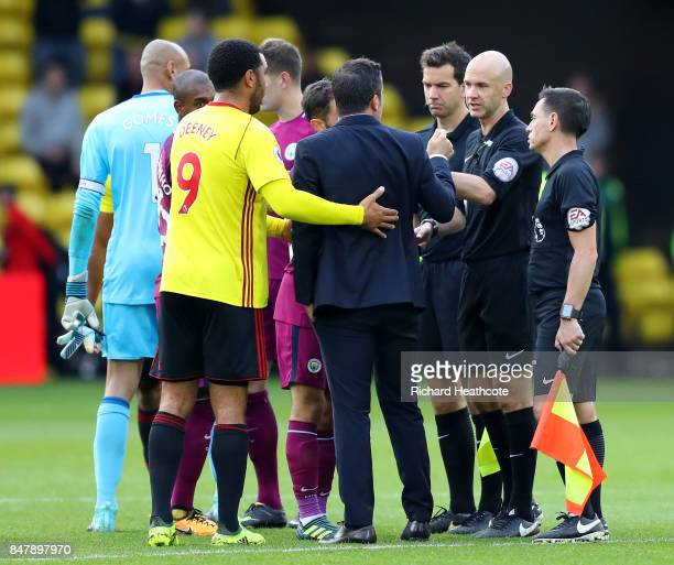 Troy Deeney of Watford and Marco Silva Manager of Watford argue with referee Anthony Taylor after the Premier League match between Watford and...