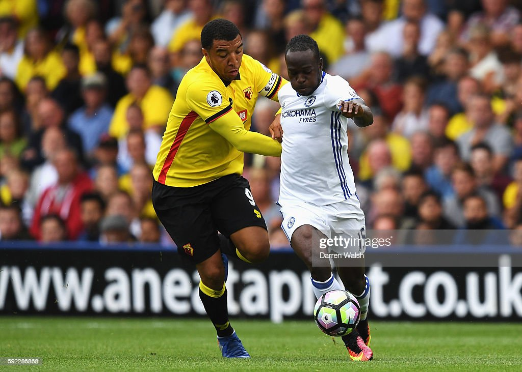 Troy Deeney of Watford and Victor Moses of Chelsea battle for possession during the Premier League match between Watford and Chelsea at Vicarage Road...