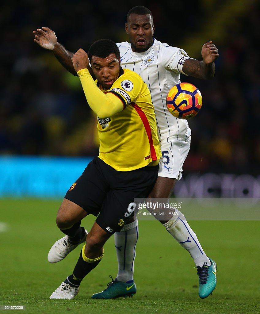 Troy Deeney of Watford and Wes Morgan of Leicester City during the Premier League match between Watford and Leicester City at Vicarage Road on November 19, 2016 in Watford, England.