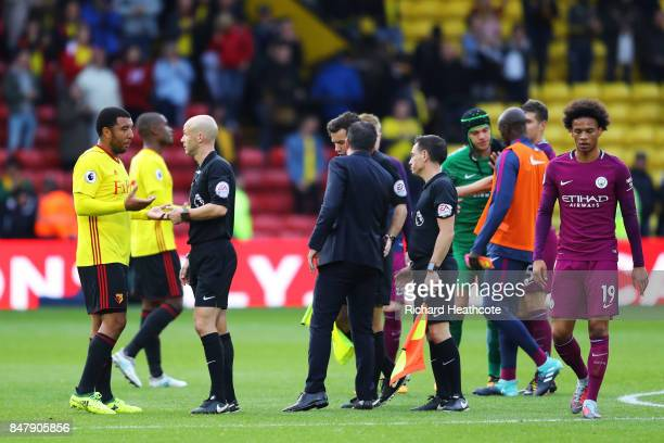 Troy Deeney of Watford argues with referee Anthony Taylor and Marco Silva Manager of Watford aruges with the fourth offical during the Premier League...