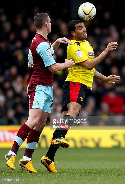 Troy Deeney of Watford battles for an aerial ball with Kevin Long of Burnley during the npower Championship match between Watford and Burnley at...