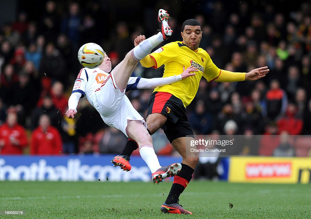Troy Deeney of Watford battles with Boltons Josh Vela for the ball during the npower Championship match between Watford and Bolton Wanderers at Vicarage Road on February 02, 2013 in Watford England.