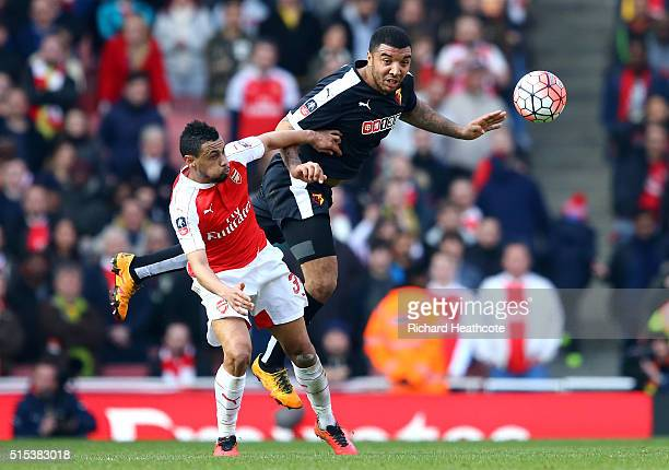 Troy Deeney of Watford beats Francis Coquelin of Arsenal to the ball during the Emirates FA Cup sixth round match between Arsenal and Watford at...