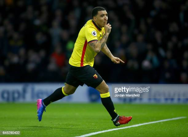 Troy Deeney of Watford celebrates as he scores the first goal from a penalty during the Premier League match between Watford and West Ham United at...
