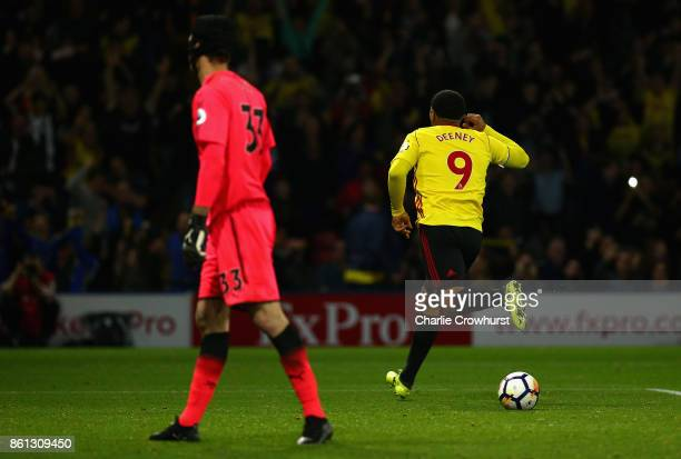 Troy Deeney of Watford celebrates as he scores their first and equalising goal from the penalty spot as Petr Cech of Arsenal look dejected during the...