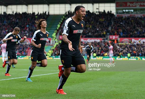 Troy Deeney of Watford celebrates scoring his team's first goal during the Barclays Premier League match between Stoke City and Watford at Britannia...