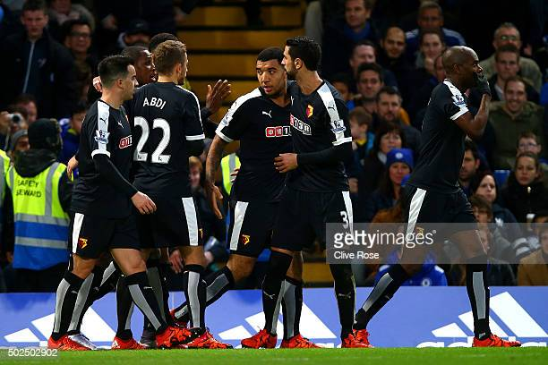 Troy Deeney of Watford celebrates with teammates after scoring their first goal from the penalty spot during the Barclays Premier League match...