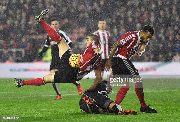 Troy Deeney of Watford competes for the ball against Oriol Romeu and Ryan Bertrand of Southampton during the Barclays Premier League match between...
