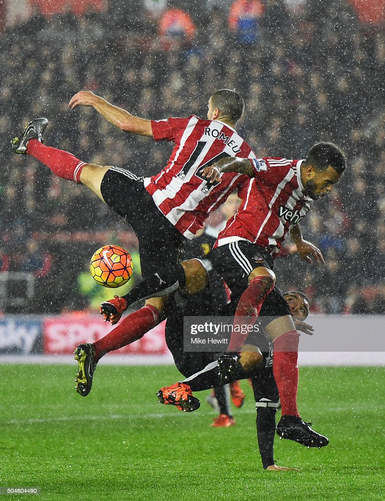 Troy Deeney (C) of Watford competes for the ball against Oriol Romeu (L) and Ryan Bertrand (R) of Southampton during the Barclays Premier League match between Southampton and Watford at St. Mary's Stadium on January 13, 2016 in Southampton, England.