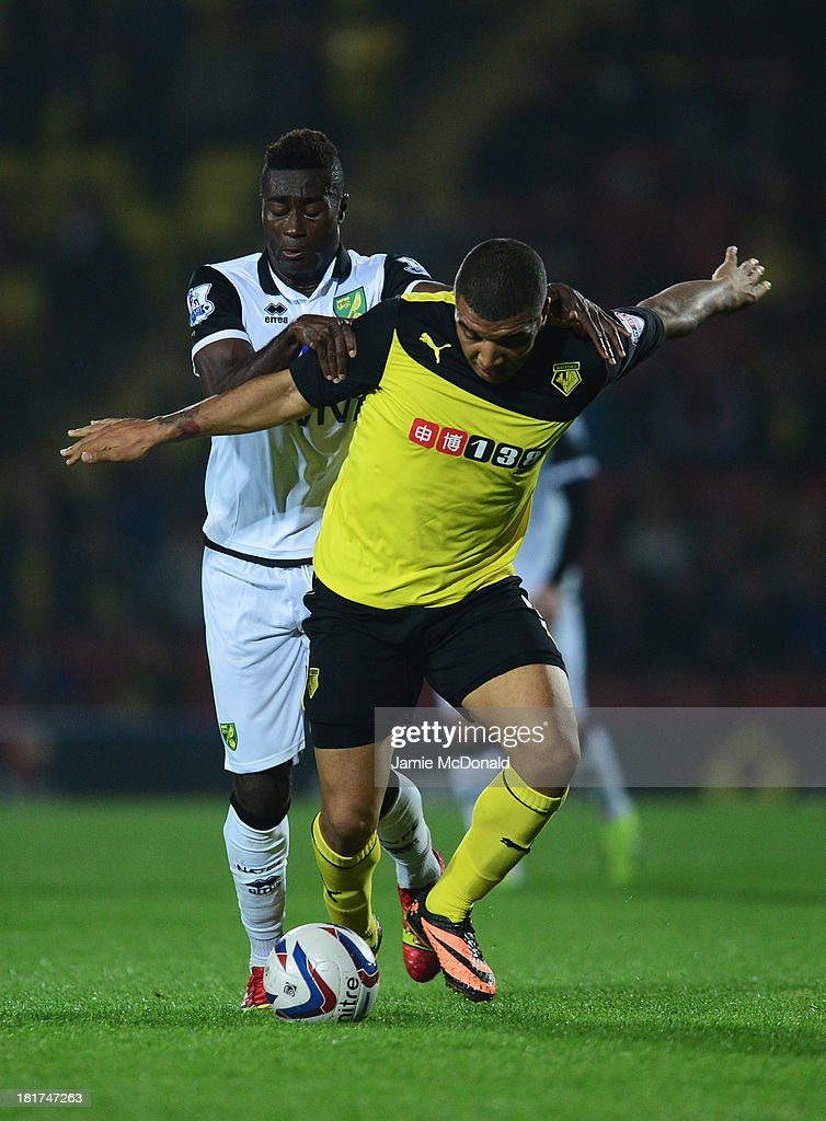 <a gi-track='captionPersonalityLinkClicked' href=/galleries/search?phrase=Troy+Deeney&family=editorial&specificpeople=4698410 ng-click='$event.stopPropagation()'>Troy Deeney</a> of Watford holds off Alexander Tettey of Norwich City during the Capital One Cup Third Round match between Watford and Norwich City at Vicarage Road on September 24, 2013 in Watford, England.