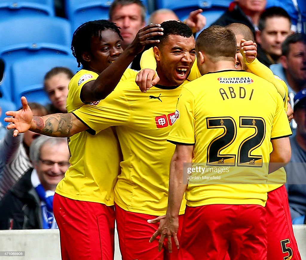 Troy Deeney of Watford is swamped by his teammates after scoring to make it 10 during the Sky Bet Championship match between Brighton Hove Albion and...