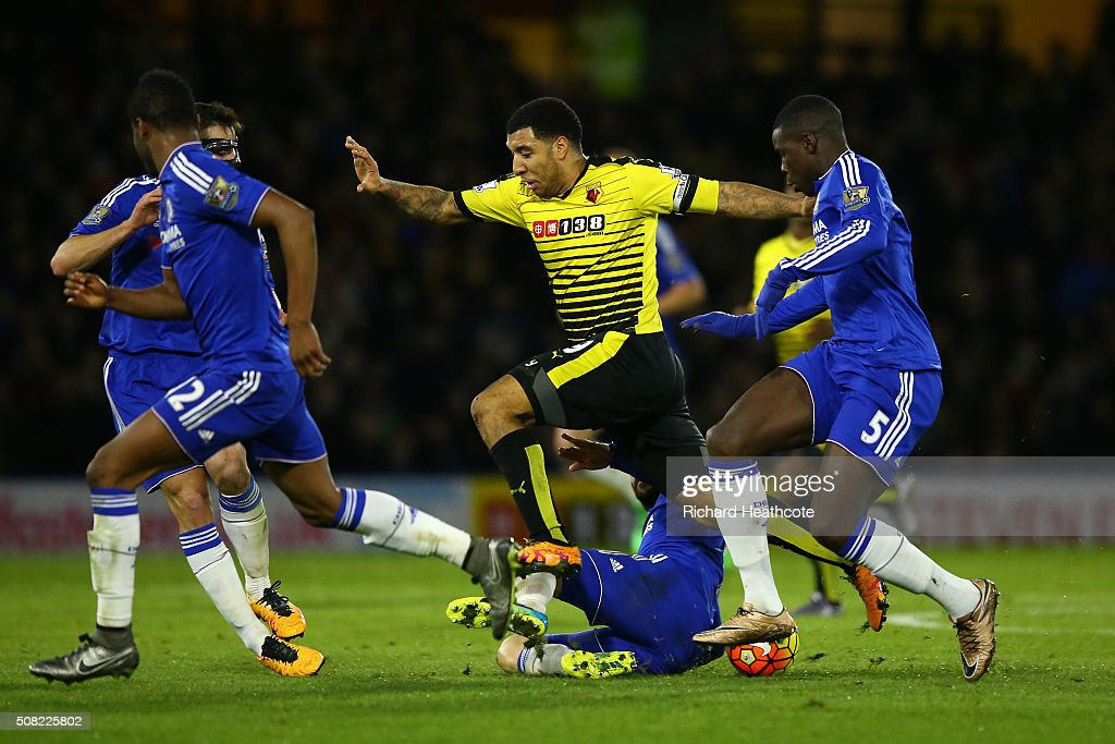 Troy Deeney of Watford is tackled by Cesc Fabregas of Chelsea during the Barclays Premier League match between Watford and Chelsea at Vicarage Road on February 3, 2016 in Watford, England.