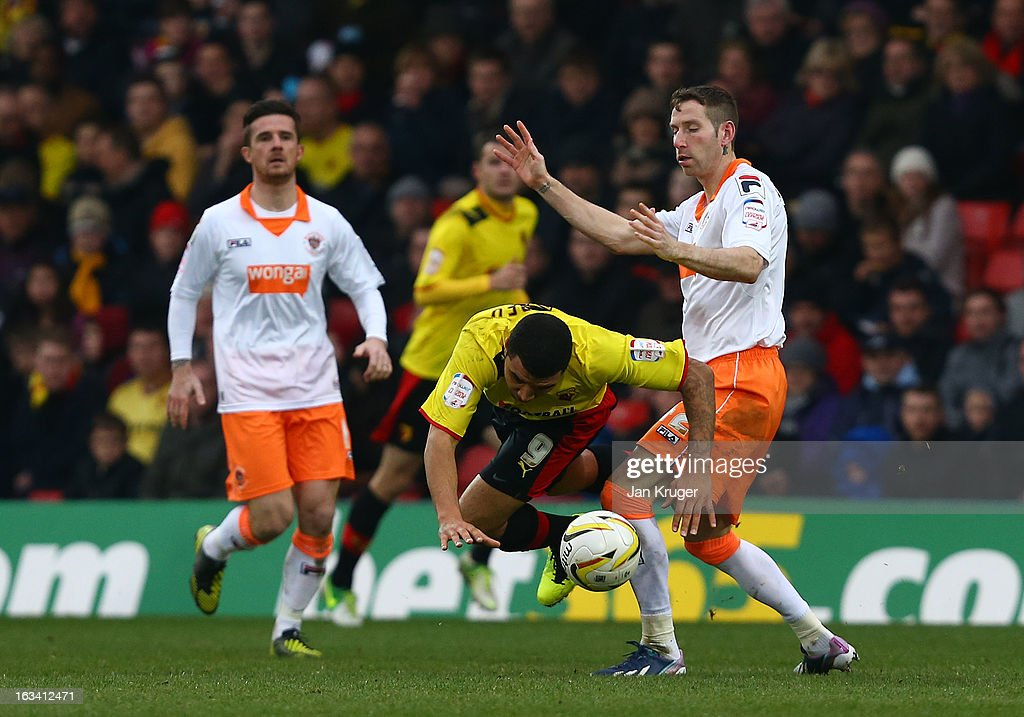 Troy Deeney of Watford is tackled by <a gi-track='captionPersonalityLinkClicked' href=/galleries/search?phrase=Kirk+Broadfoot&family=editorial&specificpeople=4143241 ng-click='$event.stopPropagation()'>Kirk Broadfoot</a> of Blackpool during the npower Championship match between Watford and Blackpool at Vicarage Road on March 9, 2013 in Watford, England.