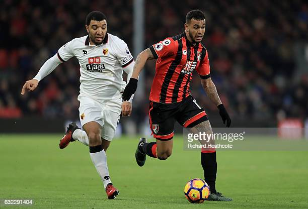 Troy Deeney of Watford puts pressure on Joshua King of AFC Bournemouth during the Premier League match between AFC Bournemouth and Watford at...