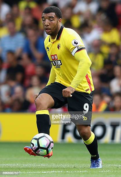 Troy Deeney of Watford runs with the ball during the Premier League match between Watford and Arsenal at Vicarage Road on August 27 2016 in Watford...