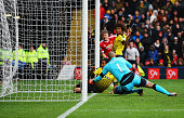 Troy Deeney of Watford scores an own goal during the Barclays Premier League match between Watford and Manchester United at Vicarage Road on November...