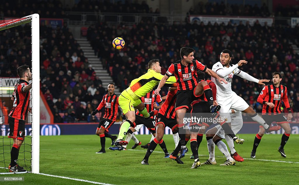Troy Deeney of Watford (R) scores his sides second goal with a header during the Premier League match between AFC Bournemouth and Watford at Vitality Stadium on January 21, 2017 in Bournemouth, England.