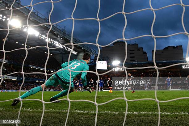 Troy Deeney of Watford scores his team's first goal from the penalty spot during the Barclays Premier League match between Chelsea and Watford at...