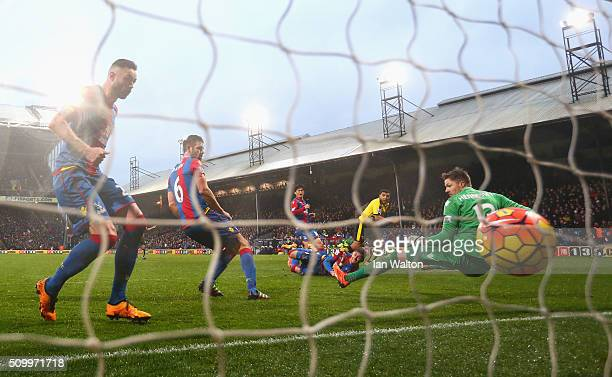 Troy Deeney of Watford scores his team's second goal past Wayne Hennessey of Crystal Palace during the Barclays Premier League match between Crystal...