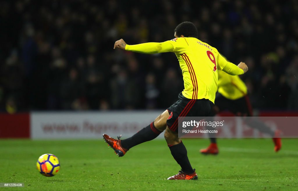 Troy Deeney of Watford scores the first Watford goal from the penalty spot during the Premier League match between Watford and Manchester United at Vicarage Road on November 28, 2017 in Watford, England.