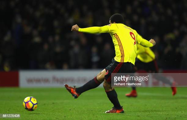 Troy Deeney of Watford scores the first Watford goal from the penalty spot during the Premier League match between Watford and Manchester United at...