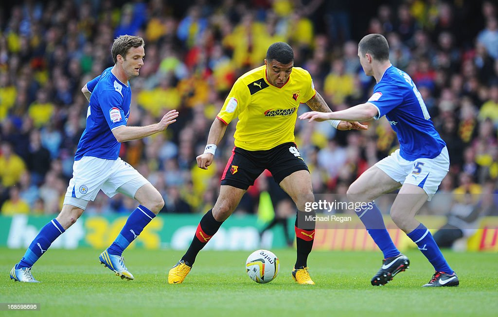 Troy Deeney of Watford takes on Michael Keane (R) and Andy King of Leicester City during the npower Championship Play Off Semi Final Second Leg match between Watford and Leicester City at Vicarage Road on May 12, 2013 in Watford, England.