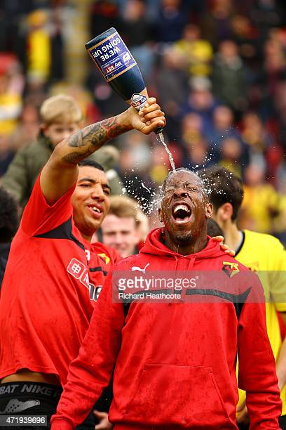 Troy Deeney pours chamagne on Lloyd Doyley as they celebrate promotion to the premier league during the Sky Bet Championship match between Watford...