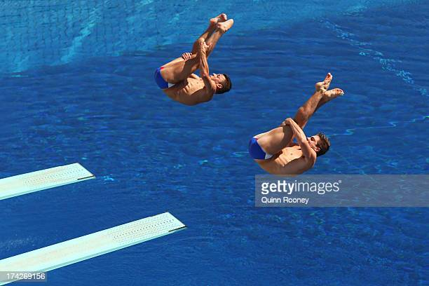 Troy Dumais and Michael Hixon of USA compete in the Men's 3m Synchro Springboard Diving preliminary round on day four of the 15th FINA World...