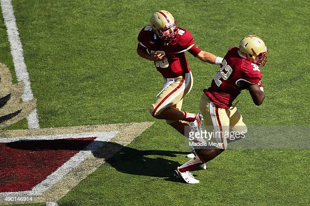 Troy Flutie of the Boston College Eagles hands the ball off to Jon Hilliman during the second quarter against the Northern Illinois Huskies at Alumni...
