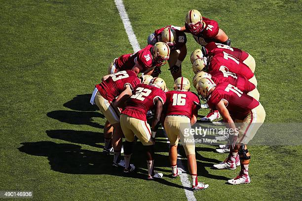 Troy Flutie of the Boston College Eagles huddles with the offense during the second quarter against the Northern Illinois Huskies at Alumni Stadium...