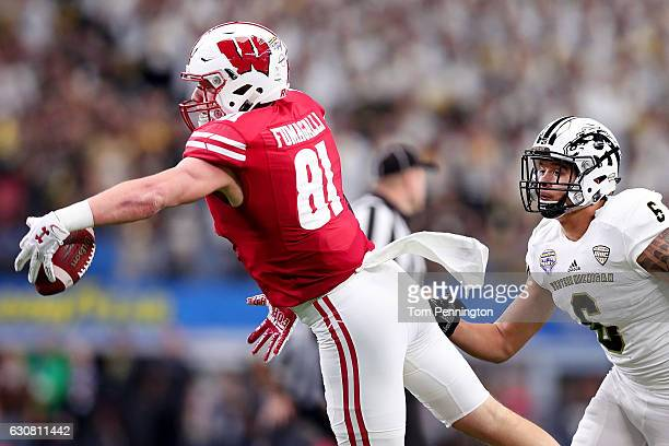 Troy Fumagalli of the Wisconsin Badgers makes a one handed catch against Asantay Brown of the Western Michigan Broncos in the first half at ATT...