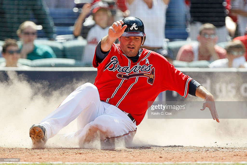 <a gi-track='captionPersonalityLinkClicked' href=/galleries/search?phrase=Troy+Glaus&family=editorial&specificpeople=204238 ng-click='$event.stopPropagation()'>Troy Glaus</a> #25 of the Atlanta Braves scores as he slides across homeplate in the eighth inning against the Kansas City Royals at Turner Field on June 20, 2010 in Atlanta, Georgia.