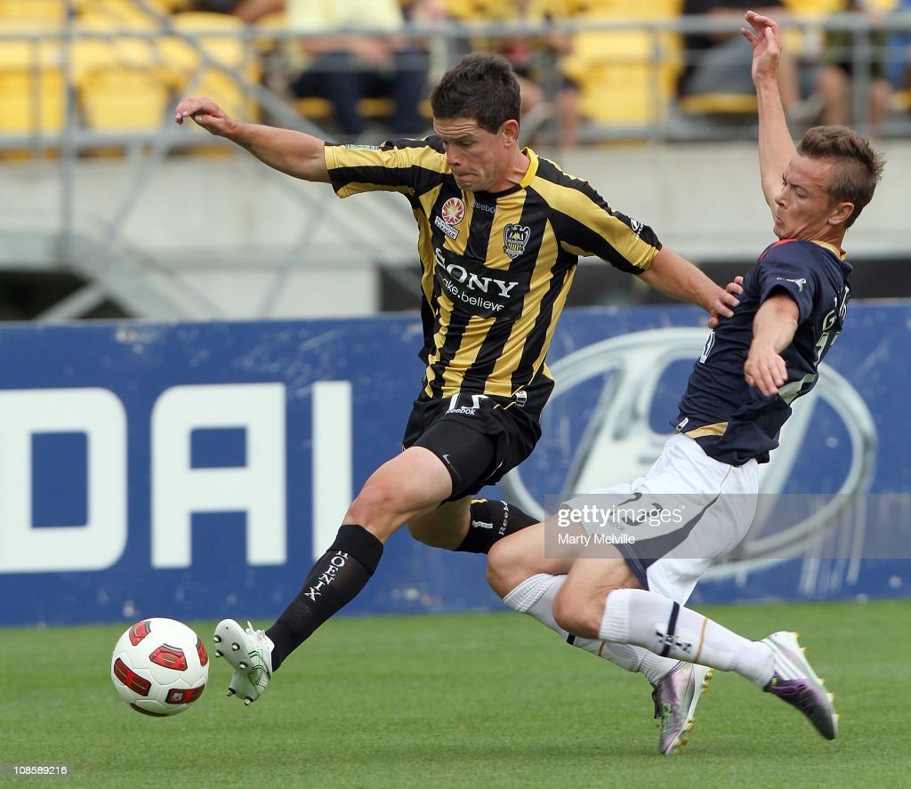 Troy Hearfield of the Phoenix is tackled by Ryan Griffiths of the Jets during the round 25 ALeague match between the Wellington Phoenix and the...