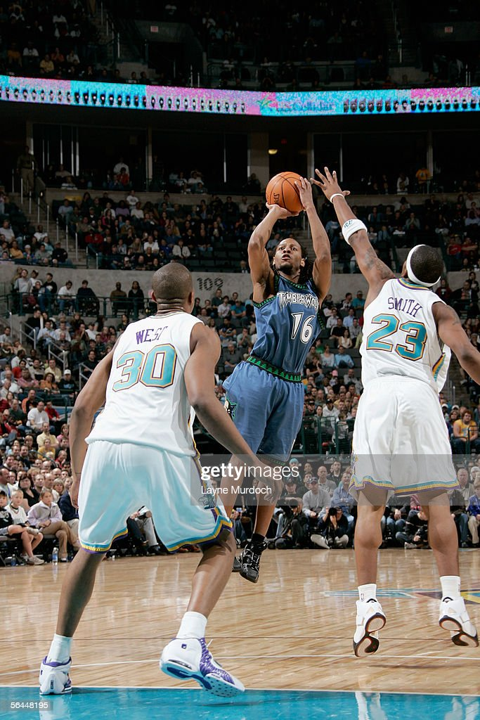 Troy Hudson of the Minnesota Timberwolves shoots over JR Smith and David West of the New Orleans/Oklahoma City Hornets during the game at the Ford...