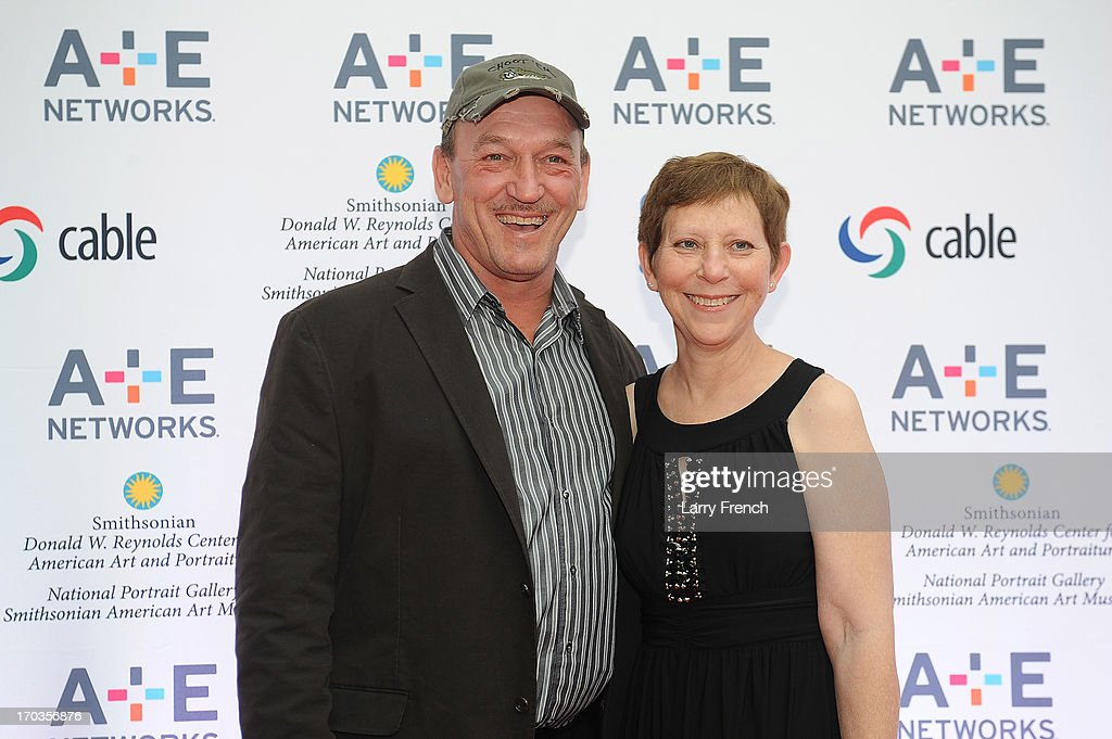 Troy Landry (L) and wife, Bernita Landry attend the A+E hosted NCTA Chairman's Reception at the Smithsonian American Art Museum & National Portrait Gallery on June 11, 2013 in Washington, DC.