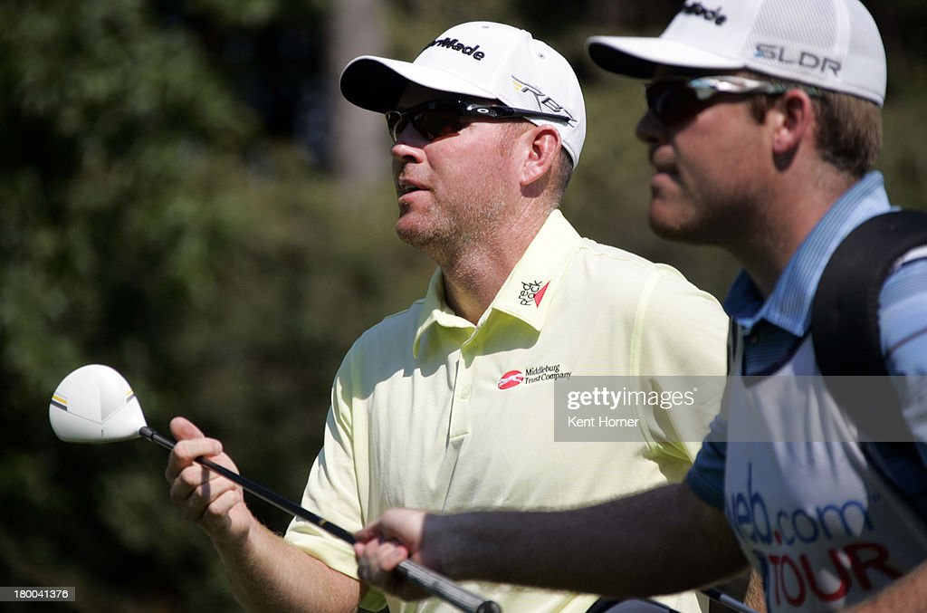 Troy Matteson hands his club to his caddie after hitting the ball off the 1st tee during the final round of the Chiquita Classic in the Webcom tour...