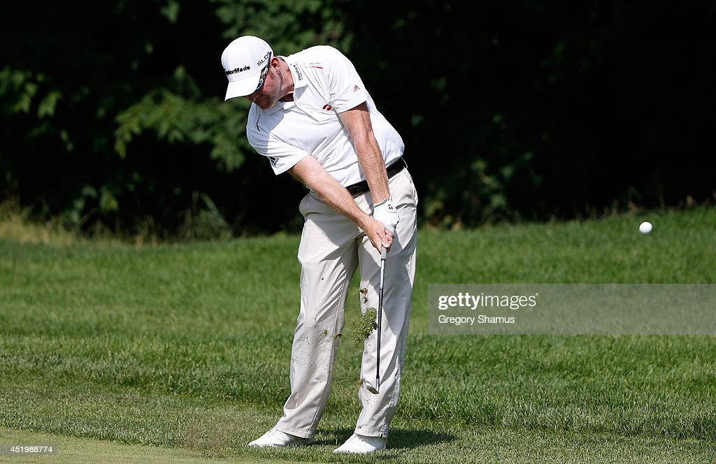 Troy Matteson hits his approach to the 15th green during the first round of the John Deere Classic held at TPC Deere Run on July 10 2014 in Silvis...