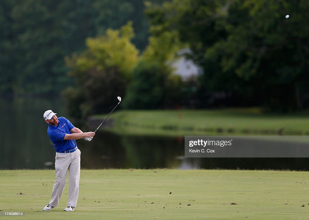 Troy Matteson hits his third shot on the 18th hole during the second round of the Sanderson Farms Championship at Annandale Golf Club on July 19 2013...