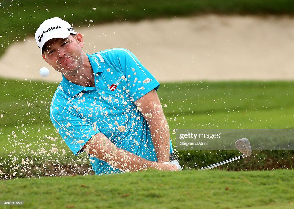 Troy Matteson hits out of a bunker on the 16th hole during the first round of the on June 5 2014 at TPC Southwind in Memphis Tennessee