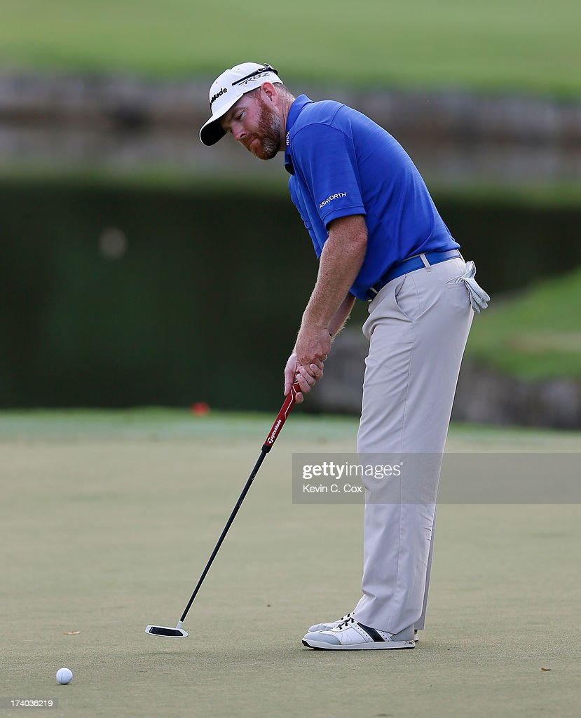 Troy Matteson putts on the 18th green during the second round of the Sanderson Farms Championship at Annandale Golf Club on July 19 2013 in Madison...