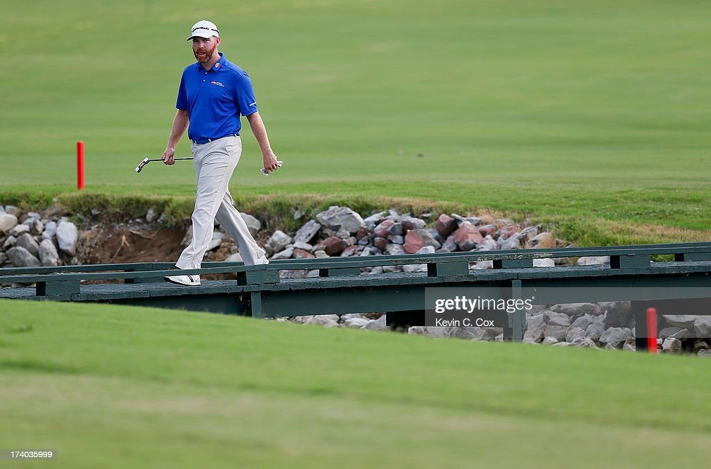 Troy Matteson walks to the 18th green during the second round of the Sanderson Farms Championship at Annandale Golf Club on July 19 2013 in Madison...