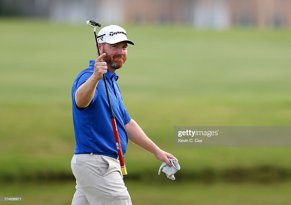 Troy Matteson waves to the spectators as he walks to the 18th green during the second round of the Sanderson Farms Championship at Annandale Golf...
